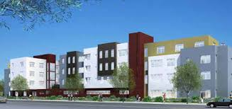 Rendering of Paloma Terrace showing a four story, multicolored building with trees in front.