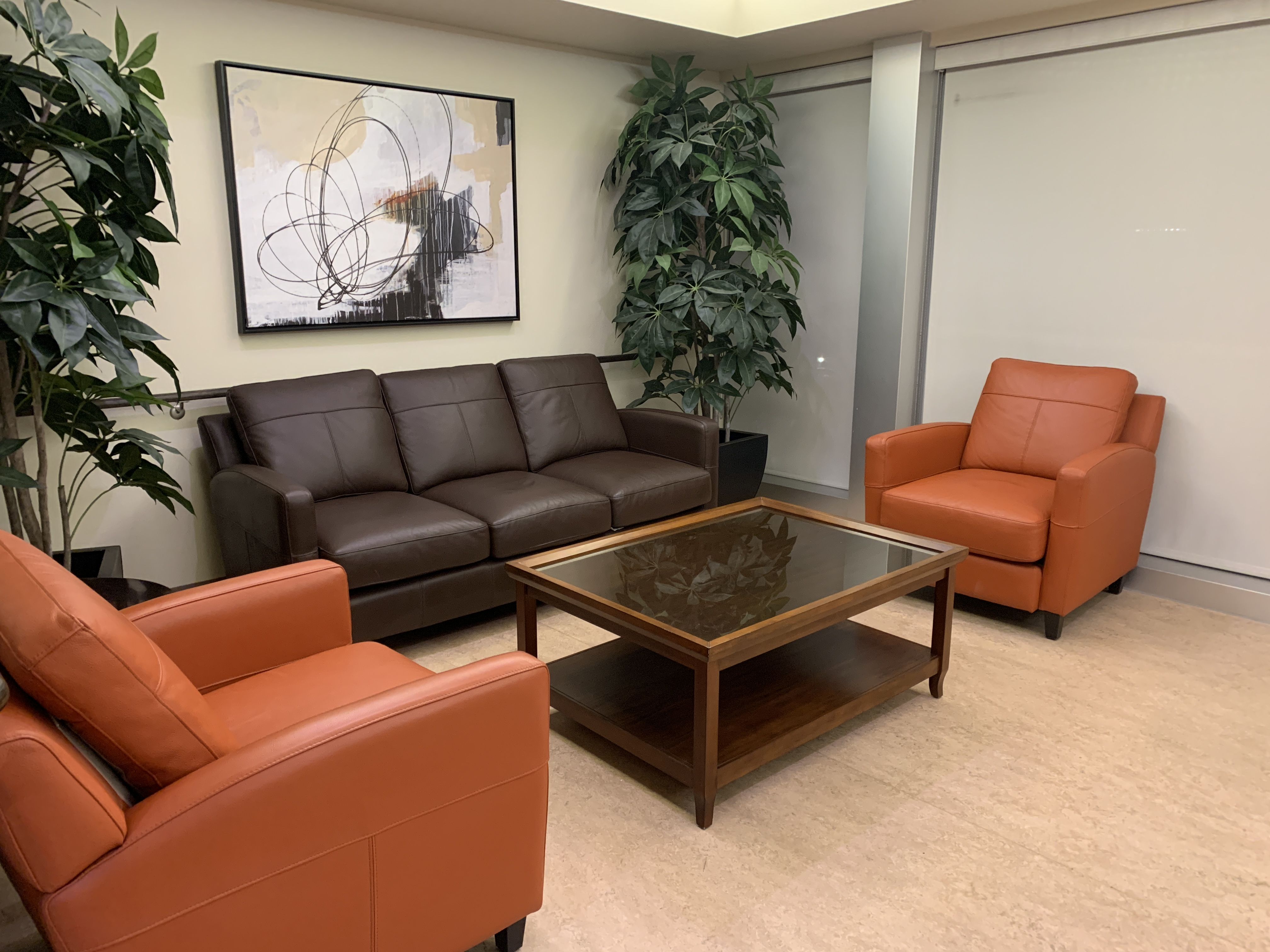 willis avenue lounge area, one is located of each floor. Room with sofa and chairs with coffee table/ decroative art and plants in room