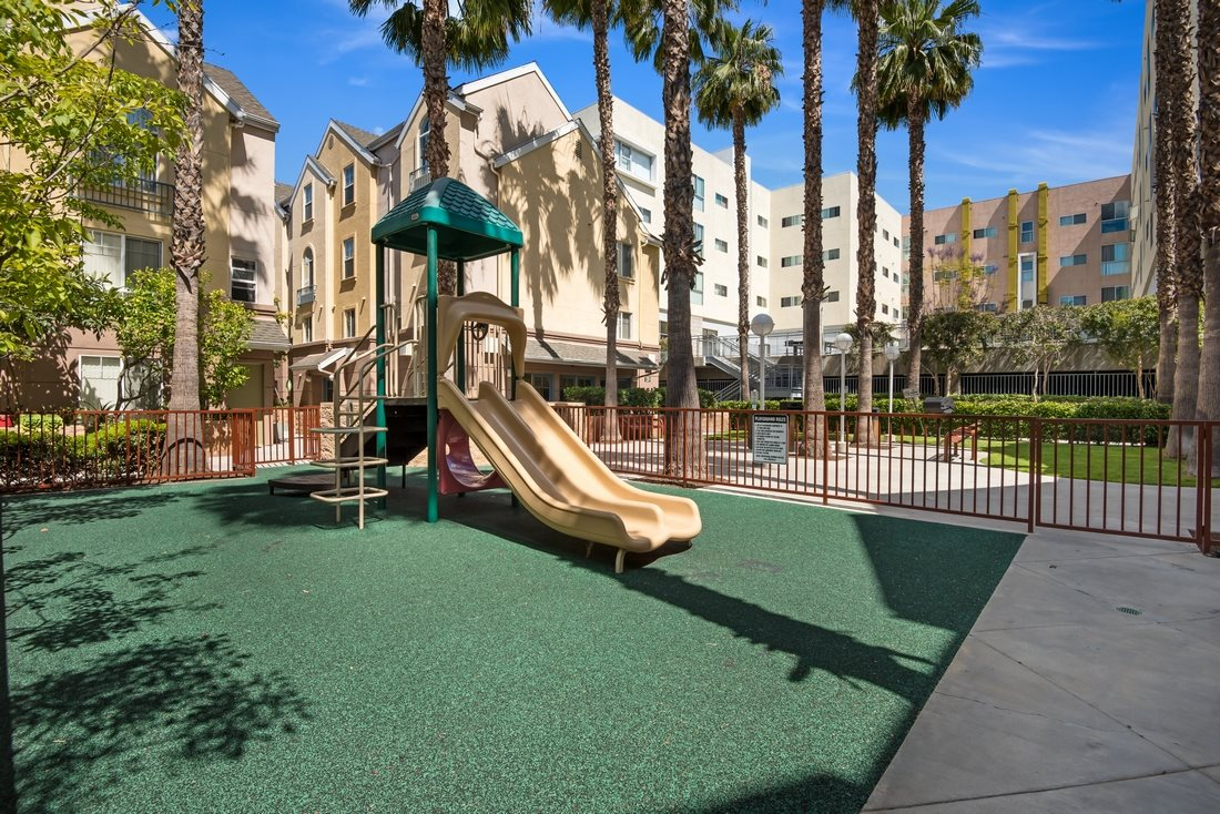 Image of the building playarea with green grass carpet