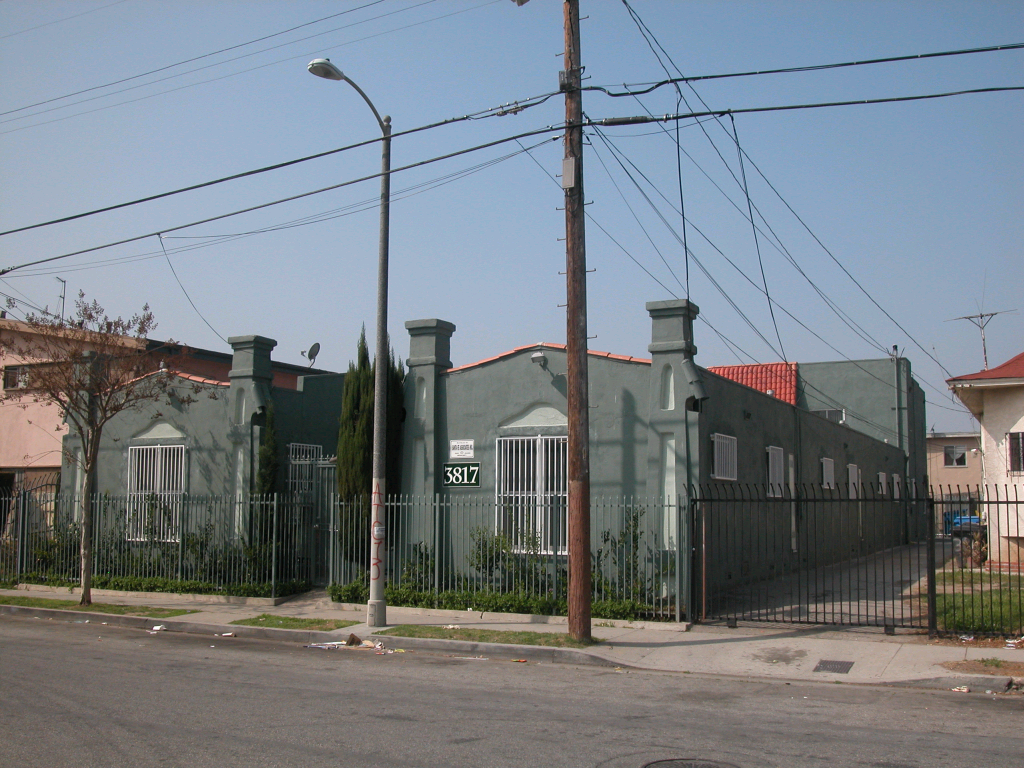 Street view of single story property in green color